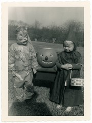 Little Red Riding Hood and the Big Bad Wolf with a Jack-o'-Lantern (Alan Mays) Tags: ephemera photographs photos foundphotos snapshots portraits halloween holidays october31 jackolanterns pumpkins children boys girls clothes clothing hats costumes masks redridinghood littleredridinghood hoods baskets bigbadwolf wolves animals fairytales folktales shadows shadowpeople photographersshadow humor humorous funny amusing cute serrated edges borders 1951 1950s antique old vintage vptp