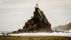 Ninepin Rock (Stefan Marks) Tags: ninepinrock tasmansea beach building island lighthouse nature ocean outdoor sand sky wave aucklandwaitakere northisland newzealand nzl
