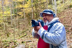 Posing with my Wide Angle Lens.   I usually will not be in front of a camera.  My Buddy Zac used my phone to document me being there.   Glad he did not take a video of me slipping in the dark gray clay on the trails! (Mike WMB) Tags: forrest fall hike nikon d500 beard bear redrivergorge
