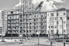 Cabels And Construction (pni) Tags: monochrome buildingsite pylon utilitypole cable wire street pavement road window wall trafficsign crane sompasaari suparn helsinki helsingfors finland suomi pekkanikrus skrubu pni