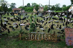 "USA Detroit Michigan east side Heidelberg Project with lotsa footwear - ""Shoe-in' It"" (moreska) Tags: usa detroit michigan eastside heisenberg project art shoes footwear junk fence neighborhood lawn graffiti travel tourism wayne county motor city north america"