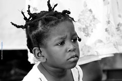 Please Mom.. (Maria Michalinos-www.debop.gr/deBlog/the-athenians) Tags: child african africa bw blackandwhite monochrome eyes sad love beautiful streetphotography urban hair ilobsterit portrait people