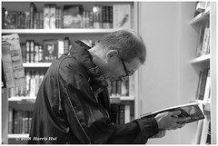 Reading Can Be Addictive - Richmond Centre XH4085e (Harris Hui (in search of light)) Tags: harrishui fujixh1 digitalmirrorlesscamera fuji fujifilm vancouver richmond bc canada vancouverdslrshooter mirrorless fujixambassador xh1 fujixcamera fujixseries fujix fujixf60mmf24 fujiprimelens fixedlens acrosfilmsimulation acros bw blackwhite digitalbw mono monochrome reading reader bookstore shoppingmall addictive goodaddiction readingpaperbooks books paperbooks street streetcandid streetphotography