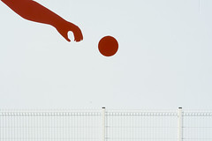 Hand, ball and fence (Jan van der Wolf) Tags: map175154v fence ball hand wall muur painting hek redandwhite rood wit
