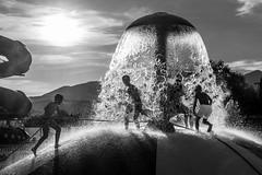 Slippery hill (Lensjoy) Tags: lensjoy splash water waterpark aquapark silhouette monochrome blackandwhite climbing wet playing boys summer