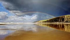 All right now (pauldunn52) Tags: rainbow southerndown dunraven beach cliffs wet sand storm reflections glamorgan heritage coast wales