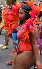 DSC_8421a Notting Hill Caribbean Carnival London Exotic Colourful Maroon Orange and Pink Costume with Ostrich Feather Headdress Girls Dancing Showgirl Performers Aug 27 2018 Stunning Ladies Big Beautiful Woman BBW (photographer695) Tags: notting hill caribbean carnival london exotic colourful maroon orange pink costume with ostrich feather headdress girls dancing showgirl performers aug 27 2018 stunning ladies big beautiful woman bbw