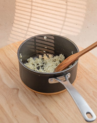 Rissotto with onion. (annick vanderschelden) Tags: cook rice hot prepared spatula wood pan handle black food italian consistency risotto belgium