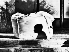 Shadow on a sack (Pomo photos) Tags: city shadow street urban profile head people man silhouette epl8 bag steps wall decay abandoned olympus streetart cityscape surreal noir abstract expressionism shape shapes architecture garbage sack sigma30mm