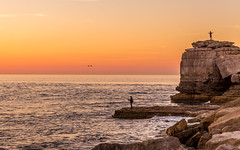 Sunset at Portland Bill (charlie raven) Tags: 2018 autumn climate clouds coast coastline dorset landscape lighthouse ocean october portlandbill rocks sea seascape seasons sky sunset uk waves weather fishing fisherman