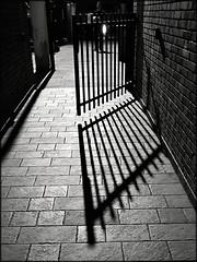 Ombre e luci (Aellevì) Tags: cancello aperto linee
