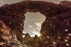 Double Arches - Rain & Shine 1 (lycheng99) Tags: doublearches arches archesnationalpark moab utah rocks rockformation rain sunrise storm weather landscape nature clouds rock northwindowarch torretarch