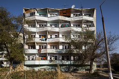 Residential building. (Stefano Perego Photography) Tags: stepegphotography stefano perego residential housing complex building concrete modernism modernist brutalism brutalist modern soviet architecture design central asia triangles geometric facade tree sky