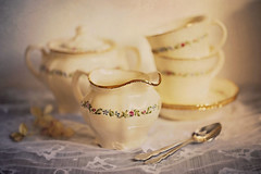 My mother in-law tea set (Through Serena's Lens) Tags: teaset sugarpot creamer cups saucers antique finebonechina dof bokeh spoons lace tabletop stilllife canoneos6dmarkii vintage
