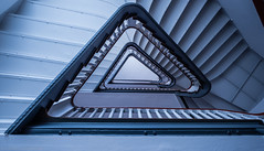 Blue Triangle (katrin glaesmann) Tags: hannover niedersachsen lowersaxony staircase treppe treppenhaus architecture triangular monochrome