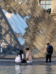 Strange reflections on the Louvre Pyramid (pivapao's citylife flavors) Tags: paris france people louvre architecture reflections