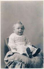 Young Child on Cushion (pepandtim) Tags: postcard old early nostalgia nostalgic young child cushion baby usa studio london provinces pen auntie uncle shoes chair