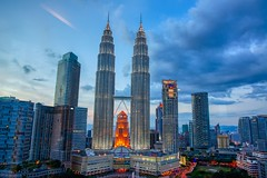 Evening view of the Petronas Towers at KLCC in Kuala Lumpur, Malaysia (UweBKK (α 77 on )) Tags: evening twilight dusk sky blue clouds petronas towers klcc building architecture city centre urban skyline lights kuala lumpur malaysia southeast asia sony alpha 550 dslr