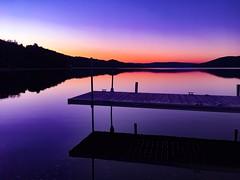 Sunset over the lake (corineouellet) Tags: quai dock sky pinksky colors colorsplash iphonography iphone sun reflet reflection lake eau waterreflet water mirrorlake sunrise sunsets sunset
