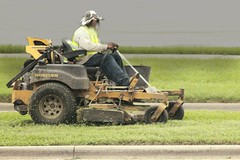 Of man and machine (MoparMadman63) Tags: mower machine mowing mow driving working person man grass clippings outdoors roadway street median cloudy suburb irvingtx texas green