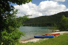 Summer afternoon at the lake (aniko e) Tags: walchensee germany water mountains summer sky kayak canoe