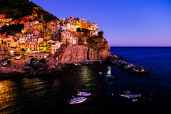 The Magical Manarola (abhishek.verma55) Tags: manarola italy colourful cityscape cinqueterre sea beautiful blue boat buildings vacation holiday houses famous italian landscape liguria scenery seascape seaside colour beauty ©abhishekverma view travel village scenic spezia sunset bay evening mediterranean cliff coast europe dreamvacation bluehour bluesky architecture flickr photography scene hill famousplaces landscapes lights outdoor outside outdoors travelphotography travelphotos vivid vibrant water wanderlust italianriviera