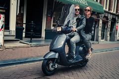 Rolling (modesrodriguez) Tags: city europe holanda holidays holland netherlands photography tourism travel moto couple people strangers