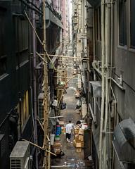 Walking (Evan Tchelepi) Tags: hongkong travel asia alley city urban bamboo buildings street color digital ricohgr