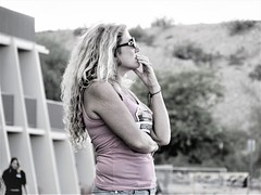 Spectator (thomasgorman1) Tags: woman tinted monochrome fan spectator racing dragboats audience canon candid streetshots streetphotos az arizona outdoors