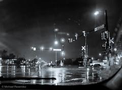 Street corner on a rainy evening (photo.po) Tags: fujifilmx100 fujifilmxseries fujifilm monochrome blackandwhitephotography blackandwhite windshield winds reflections streetlights rain streetphotography street