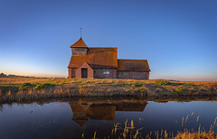 St Thomas a Becket Church, Romney Marsh (jor5472) Tags: isolated oldbuilding religious architecture ancient old history historic landmark stthomasabecket fordmadoxford wideangle tripod churchofengland parishchurch sunset reflection water tomstoppard raywinstone dominiccumberpatch parade'send visitbritain visitengland landscape televisionseries greatexpectations bbc scenery scenic beautiful nikon flickr britain greatbritain england romney marsh fairfield romneymarsh kent church