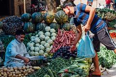 Baldeo Vegetable Market, Uttar Pradesh India (AdamCohn) Tags: 014kmtobaldevinuttarpradeshindia adamcohn baldeo baldev india uttarpradesh commerce geo:lat=27408071 geo:lon=77822368 geotagged holi man market street streetphotography vegetables vendor wwwadamcohncom