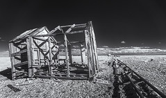 In need of attention (David Feuerhelm) Tags: monochrome blackandwhite bw schwarzundweiss noiretblanc contrast infrared wideangle wood rails abandoned building ruin shack hut sky dungeness kent ir nikon d90 sigma1020mm perspective england uk