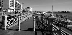 brighton (amazingstoker) Tags: brighton sea front promenade pebble beach pier bollard railing monochrome black white panorama side england queens hotel
