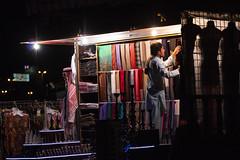 Dubai Salesman (mopics347) Tags: dubai unitedarabemirates 2015 uae salesman shopkeeper scarves night light dark outdoor deira creek wares colorful
