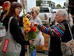 Flower Power In The Market (FrogLuv) Tags: detroitmichigan streetphotography easternmarket photowalk people farmersmarket flowers clocked