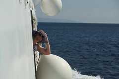 Hold On To Your Hat (steve_whitmarsh) Tags: greece water sea ocean marine portrait niqui topic blue white boat ship