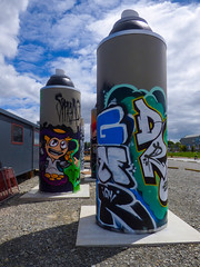 Canned Street (Steve Taylor (Photography)) Tags: graffiti streetart spray aerosol newzealand nz southisland canterbury christchurch cbd city bike bicycle cycle rider cloud sky can fence chainlink tag octopus squid smeag