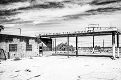 Mecca, California (paccode) Tags: solemn mojave lonely desert street blackwhite quiet clouds california abandoned monochrome urban gasstation d850 sky creepy forgotten landscape scary serious mecca unitedstates us