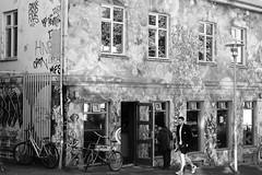 Down the street (June in Summer) Tags: street city bw art blackandwhite reykjavik store building graffiti shop