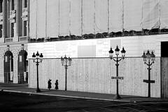 Between streetlights (pascalcolin1) Tags: paris concorde femme woman réverbères streetlights soleil sun ombres shadows photoderue streetview urbanarte noiretblanc blackandwhite photopascalcolin 5omm canon50mm canon