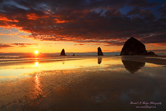 Sunset With Haystack Rock and the Needles from Cannon Beach on the Oregon Coast (@randalljhodges) Tags: sunset haystackrock sunstar cannonbeach oregon pacific ocean coast oregoncoast westcoast theneedles rockformation monolith travel scenic destination usa unitedstates landscape