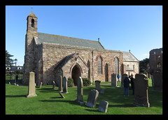 St Mary's Church. Lindisfarne (M E For Bees (Was Margaret Edge The Bee Girl)) Tags: lindisfarne stmaryschurch church christianity celtic northumberland stone architecture building canon gravestones graveyard blue sky summer sun shadows holyisland green grass old