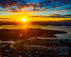 Port of Seattle Seaport Under An October Sunset From 2,504 Feet (AvgeekJoe) Tags: aerialphotograph clouds d5300 dslr elliottbay kingcounty lensflare nikon nikond5300 portofseattle pugetsound seattle tamron18400mm tamron18400mmf3563diiivchld usa washington washingtonstate aerial aerialphoto aerialphotography solarflare sunset