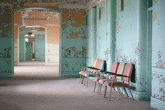 ...the wait... (Art in Entropy) Tags: abandoned urbex photography explore exploration adventure urban decay hallway chairs mental hospital creepy grime medical psychiatric