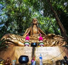 Khruba Srivichai (Matt Molloy) Tags: mattmolloy photography big gold statue khrubasrivichai sitting detailed art flowers trees water bottle cups icense bowls thai writing theravada buddhist religion symbolism watphrathatdoisuthep chiangmai thailand lovelife