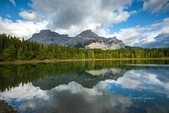 Wedge Pond, Alberta (Margarita Genkova) Tags: clouds sky lake water green fall mountains reflection rockymountains canada alberta wedgepond