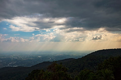 Sun Beams Over Chiang Mai (Matt Molloy) Tags: mattmolloy photography watphrathatdoisuthep temple lookout sky clouds light beams rays crepuscularrays bird trees mountain buildings city chiangmai thailand landscape lovelife