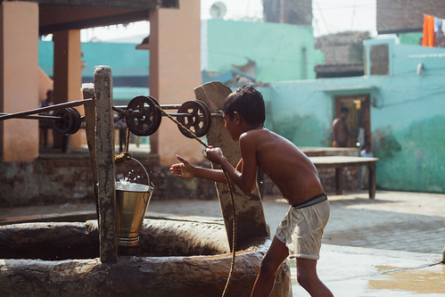 Boy Fetching Water from Well, Uttar Pradesh India