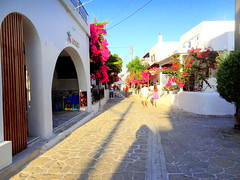 Antiparos Town. Main Street at Early Evening (dimaruss34) Tags: newyork brooklyn dmitriyfomenko image sky greece antiparos street buildings people evening flowers shadow pavement flagstones restaurant tables chairs posts